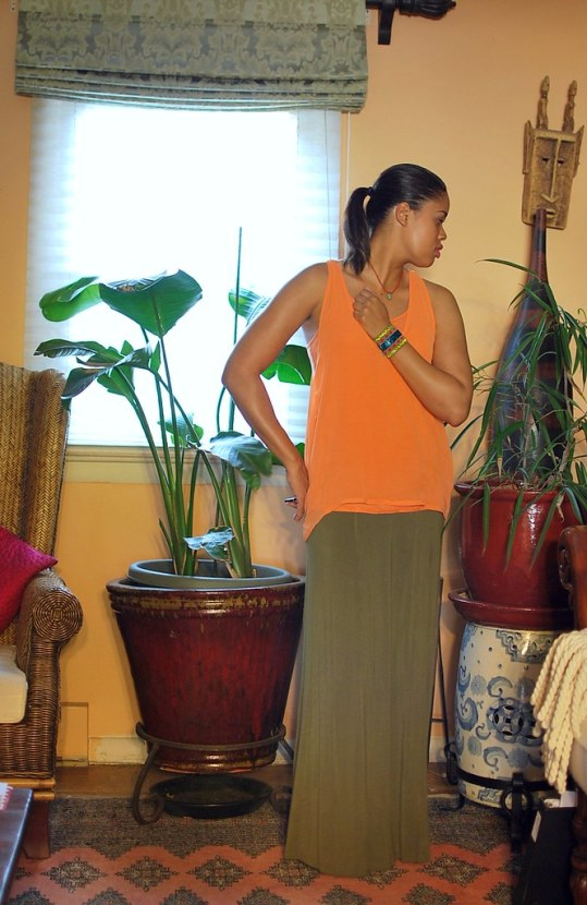 green maxi skirt and orange top