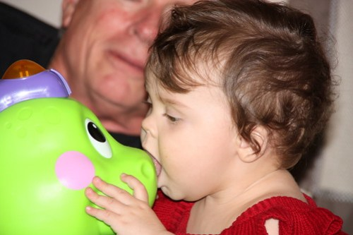 kissing the dinosaur