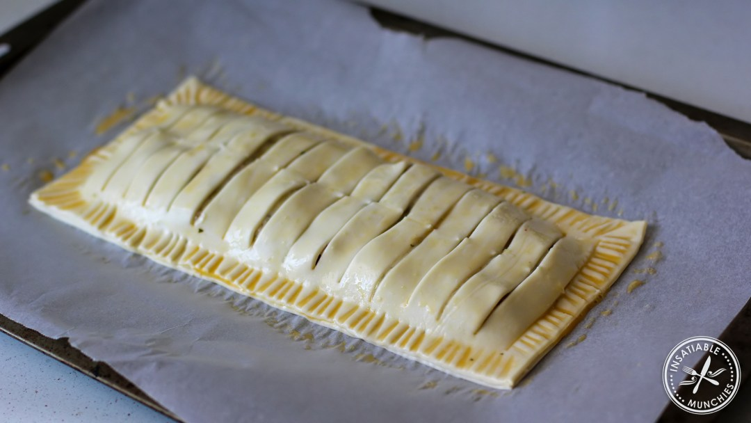 Brush the sealed pie with egg before putting the pie in the oven.