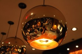 PICA light fixtures reflecting lounge party