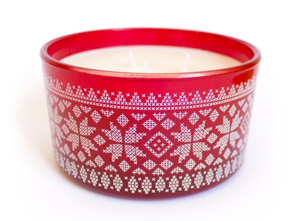 Candle with nordic cross stitch motifs