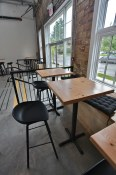 High top seating with cushions by the window | Main Street Brewing