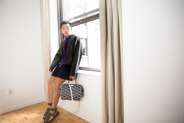 Bryanboy wears a sweater from Acne Studios, shorts from 3.1 Phillip Lim and purple Prada scarf