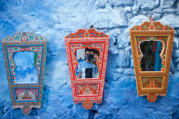 Fashion blogger Bryanboy takes a selfie at Chefchaouen, Morocco