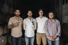 A team picture in Los Danzantes Mezcal tasting room.