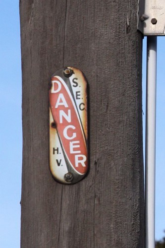 "Warning sign on a Melbourne power pole - ""DANGER: S.E.C. H.V"""