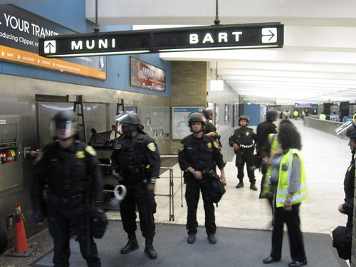 SFPD and BART Officers at Civic Center Station Entrance during August 15 protest (photo by Mina Kim/KQED)
