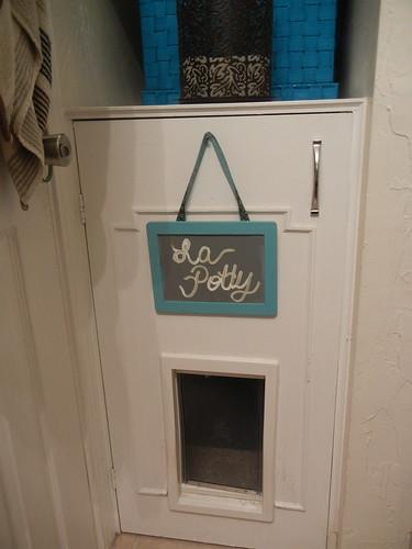 Behind that door is a cat box.