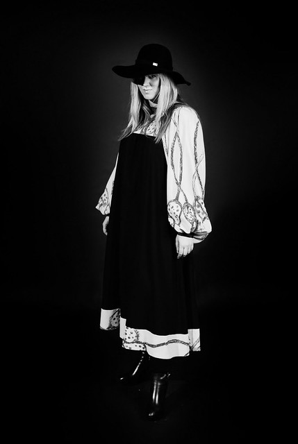 Mandi wears dress by Roksanda Ilincic, hat by Chanel, boots by Louis Vuitton, Photograph by Alistair Allan