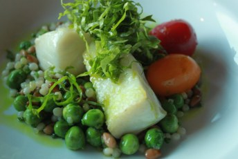 Aura | Seared Fresh Pacific Halibut with Green Cerignola Olives English Peas, Gem Tomatoes, Basil Oil, Pinenuts