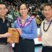 University of Hawaii Alumni Association's Patrick Oki, far left, and Alvin Katahara, far right, presented the award to Hawaiian Airlines' Debbie Nakanelua-Richards.