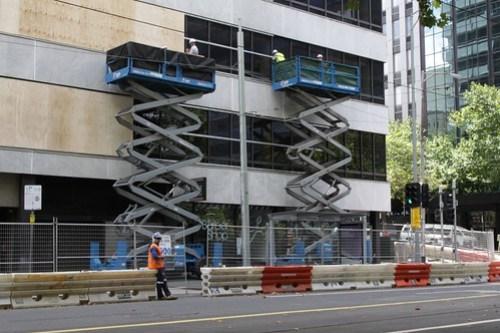 Covering the Flinders Lane facing windows of 447 Collins Street