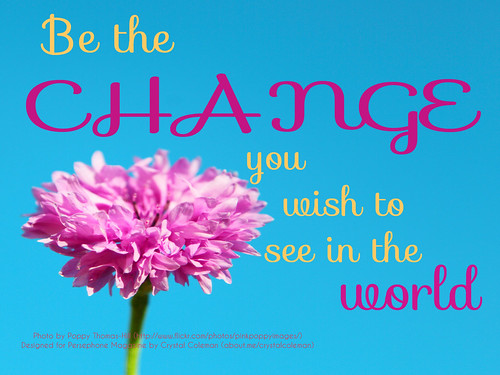"A photograph of a flower with the text ""Be the change you wish to see in the world."""