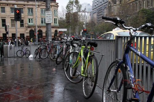 Bikes chained up outside Flinders Street Station