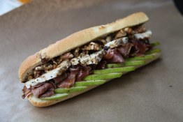 Finch's famed baguette sandwich with pear, blue brie, walnuts, proscuitto sandwich at the original Finch's