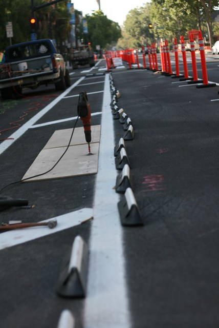 rubber curbs installed 4th street Cycletrack