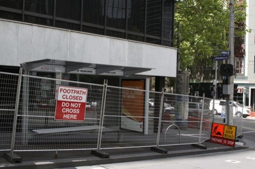 'Footpath closed' sign at William Street and Flinders Lane, the area blocked off in case anything else falls