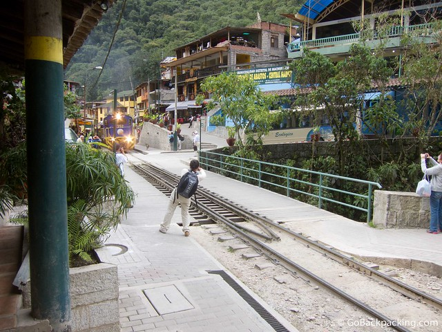 Peru Rail train pulls through Aguas Calientes