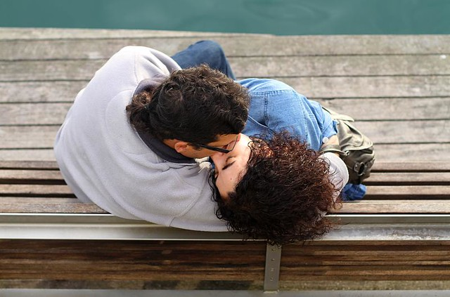A couple kissing at the pier, Barcelona, Spain