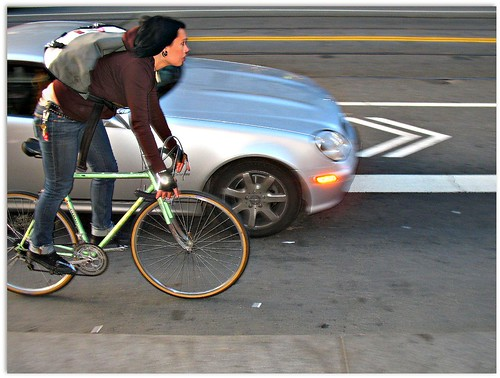 Market Street cyclist getting the squeeze