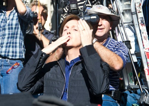 Paul McCartney blows kisses to the crowd