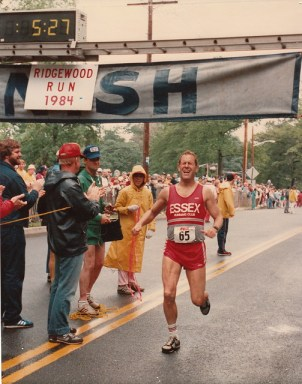 Runner at the finish line, clock reads 5:27