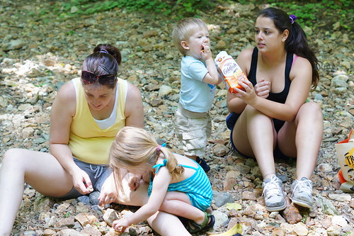 Our au pair out on a nature hike by the river with the family.