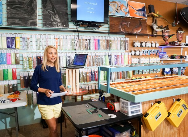 Debbie Hanson of SheFishes2 Welcomes Attendees to Women, Waders & Wine at West Wall Fly Shop, Port Charlotte, Fla., May 20, 2016