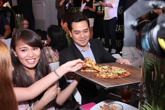 JLC serving pizza