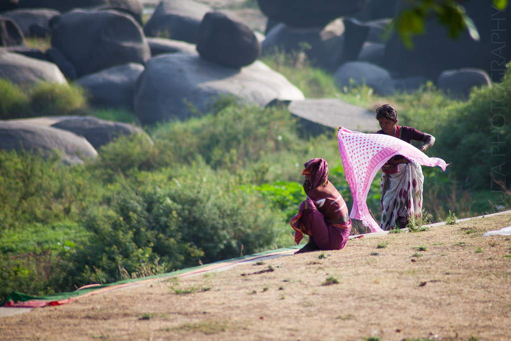 Ladies dry their saris after bathing in the river.