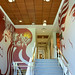 A stairwell in Hale'ōlelo, the new home of the University of Hawai'i at Hilo's Ka Haka 'Ula O Ke'elikōlani College of Hawaiian Language.  On the left is an image of Papa, mother earth, with exerpts from a mele, or song, written in honor of Princess Ruth Ke'elikōlani,  for whom the college is named. The image on the right is of  Wakea, father sky, with exerpts from traditional chants that describe the birthing of the Hawaiian islands.