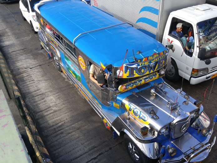 top view of blue jeepney with The Watch Tower written on it