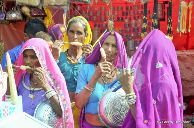 Ladies of Rajasthan in their colorful attire, beating the heat with Kulfi, an Indian style Desi Icecream