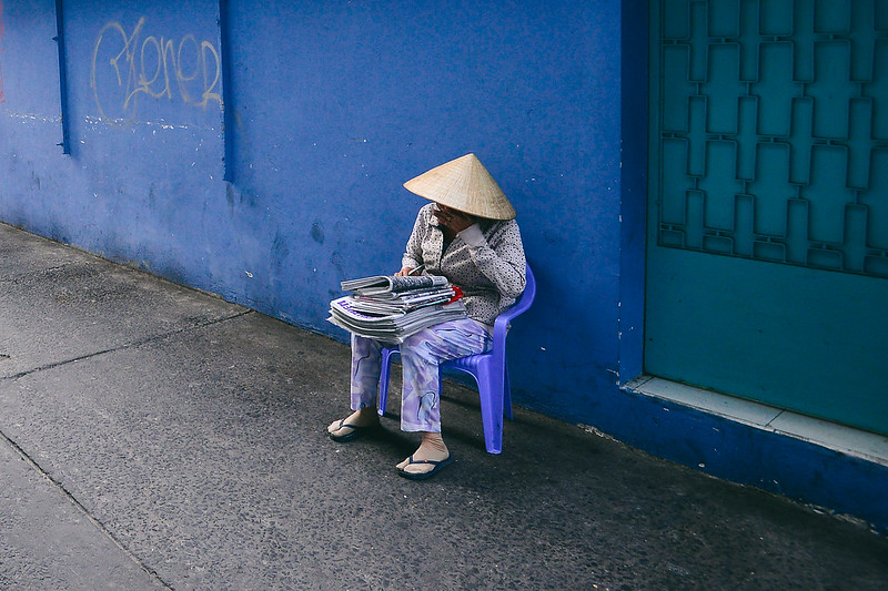 Lady on the street of Saigon, Vietnam by Owen Ballesteros