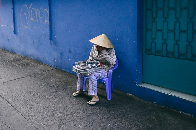 Lady on the street of Saigon, Vietnam by Owen Ballesteros