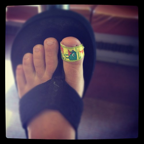 Rocking a sweet Phineas and Ferb bandaid on my blister. Love the bright yellow!