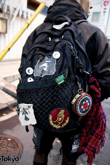Street Style Tokyo - Black Undercoverism Backpack with Patches and Net