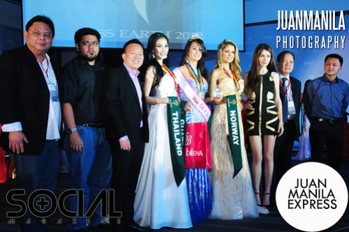 The winners Waratthaya Wongchayaporn from Thailand, Stefany Miranda of Guatemala, and Nina Fjalestad of Norway together with the  judges of the Evening Gown Competition at SMDC Grand Showroom in Pasay City.