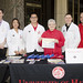 President M.R.C. Greenwood with students and faculty from the UH Hilo College of Pharmacy.