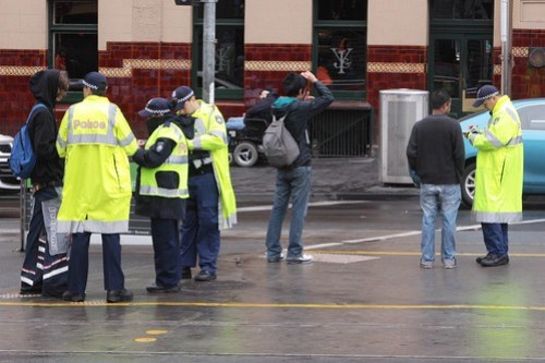 Police book jaywalkers outside Flinders Street Station
