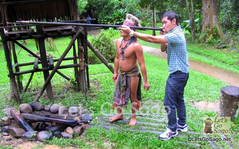 Shooting arrows using some tribal wooden tubules