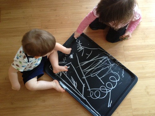 Kids playing on the chalkboard platter