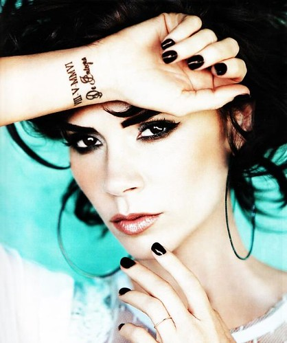 victoria beckham 's right hand tattoo