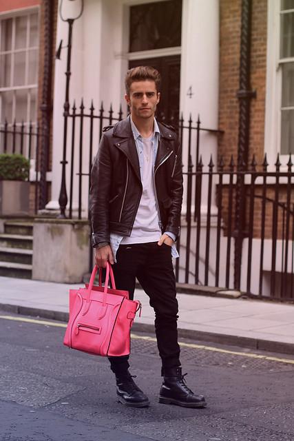 April77 black jeans, DM boots, vintage denim shirt and a biker, Celine luggage tote in Neon Pink.
