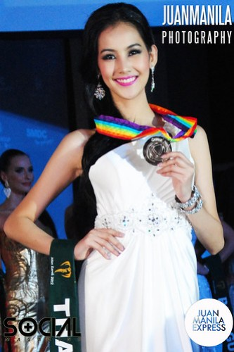 Waratthaya Wongchayaporn from Thailand shows her prize as Second Place for the Best in Evening Gown Competition.