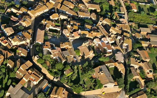 Hot air ballooning over a medieval village in Costa Brava, Catalunya, Spain