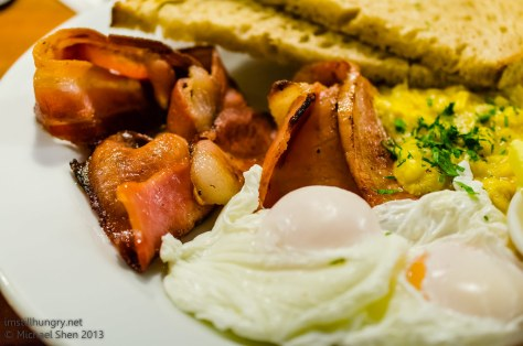 Four Ate Five Homemade creamed corn topped w/two poached eggs & crispy bacon, served w/organic sourdough toast