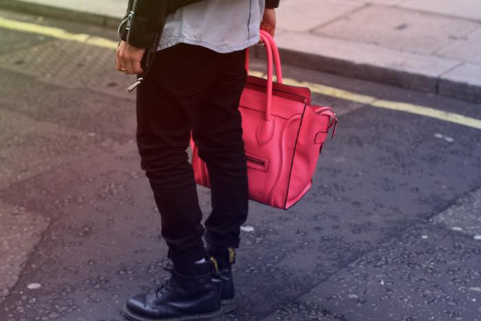 April77 black jeans, DM boots, vintage denim shirt and a biker, Celine luggage tote in Neon Pink.4