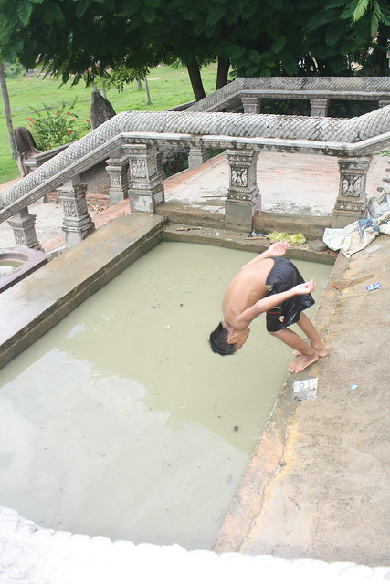 Cambodia Kid Diving into a Pool