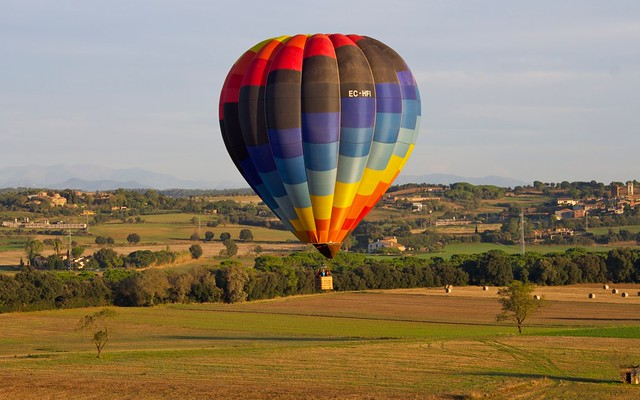 Hot air ballooning over Costa Brava, Catalunya, Spain with the Pyrenees in the north.